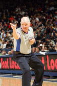 Official Joe Crawford makes a call during the game between the Utah Jazz and Golden State Warriors at the Arena in Oakland on November 5 2004 in...