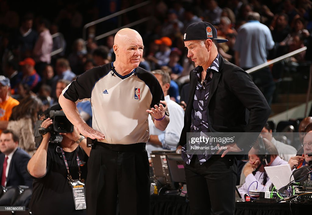 NBA Official Joey Crawford speaks with tennis legend John McEnroe in Game Two of the Eastern Conference Semifinals between the Indiana Pacers and the New York Knicks during the 2013 NBA Playoffs on May 7, 2013 at Madison Square Garden in New York City.