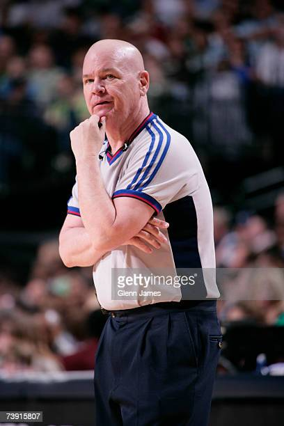 NBA official Joey Crawford stares at Tim Duncan of the San Antonio Spurs during action against the Dallas Mavericks April 15 2007 at the American...