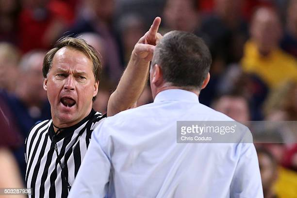 Official John Higgins ejects head coach Bobby Hurley of the Arizona State Sun Devils during the second half of the college basketball game at Wells...