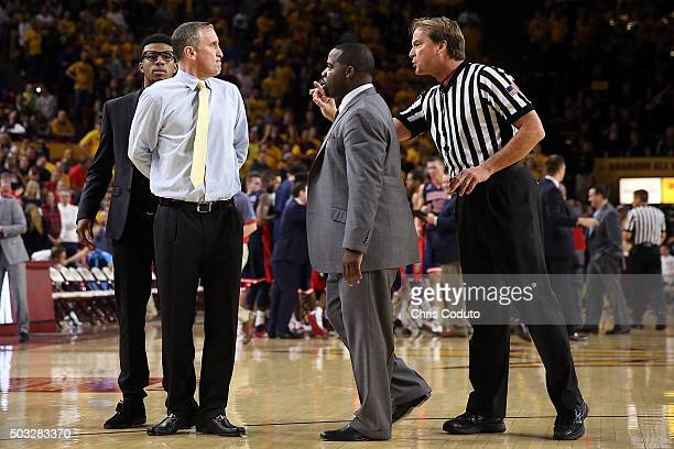 Official John Higgins gestures at head coach Bobby Hurley of the Arizona State Sun Devils during the first half of the college basketball game...