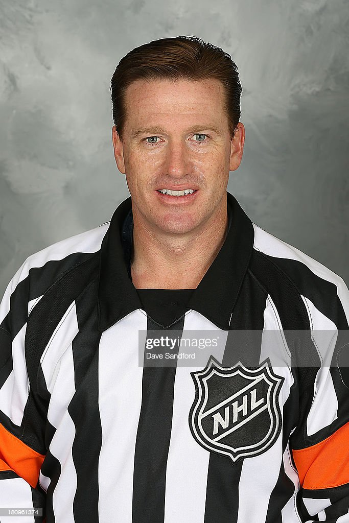 NHL Official <a gi-track='captionPersonalityLinkClicked' href=/galleries/search?phrase=Kelly+Sutherland&family=editorial&specificpeople=804878 ng-click='$event.stopPropagation()'>Kelly Sutherland</a> #11 poses for his official headshot for the 2013-2014 season on September 11, 2013 at the Beaver Valley Community Centre in Thornbury, Ontario, Canada.