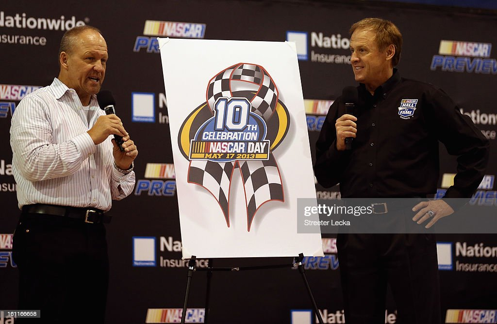 Official NASCAR artist, Sam Bass, introduces his design for the new NASCAR Day pin with Hall of Fame inductee Rusty Wallace during the NASCAR Preview at the NASCAR Hall of Fame on February 9, 2013 in Charlotte, North Carolina.