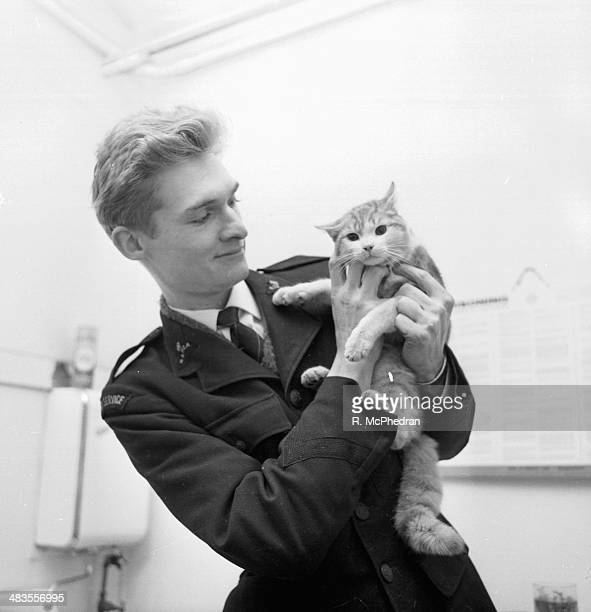 RSPCA official Nigel Bligh holding a rescued kitten January 1964