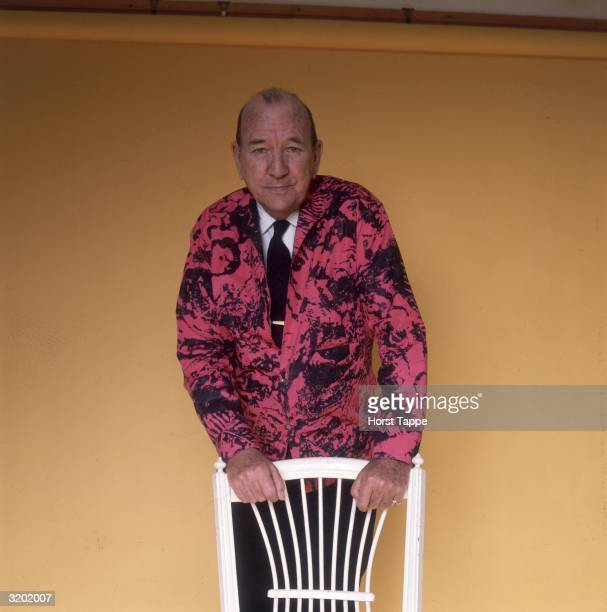 Official portrait of English playwright actor writer composer and lyricist Noel Coward for his 70th birthday He is wearing a fuchsiaandblack printed...