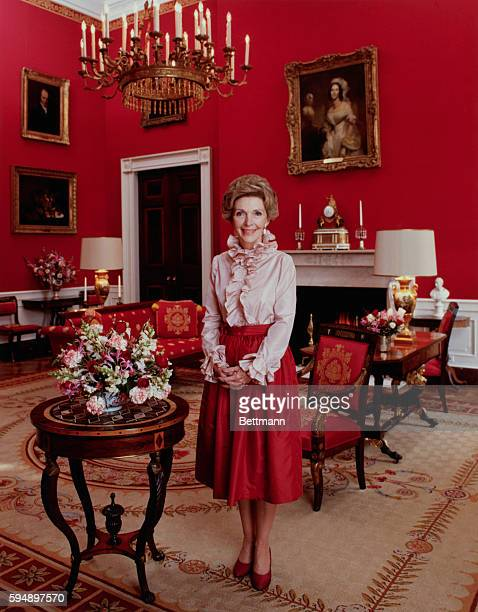 Official portrait of First Lady Nancy Reagan smiling in the White House