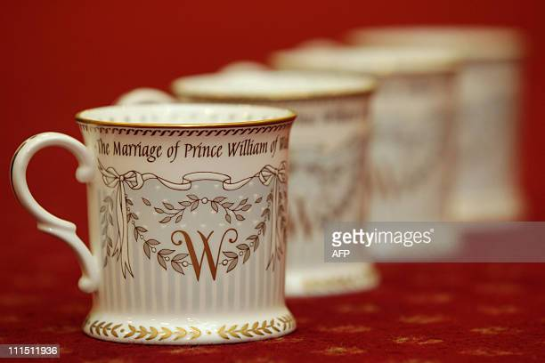 Official royal wedding commemorative china cups are displayed at the Queen's Gallery shop in central London on March 22 2011 Britain's Prince...