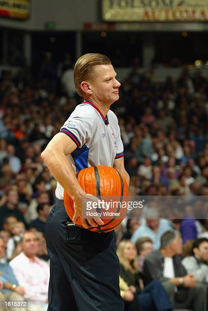 Official Steve Javie carries a pumpkin basketball during the Halloween Festivities before the NBA game between the Kings and the Portland Trail...