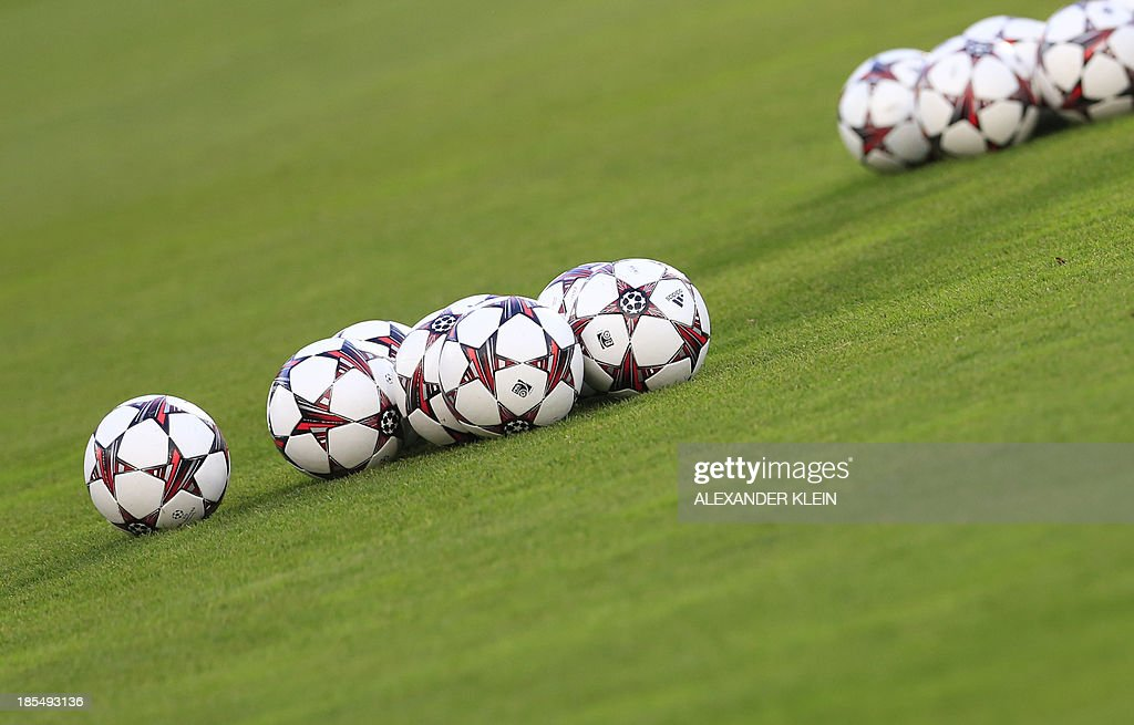 Official UEFA champions league balls are seen during a training session of Austrian football club Austria Wien in Vienna on October 21, 2013 on the eve of their group stage UEFA Champions League football match between Austria Vienna and Atletico de Madrid.