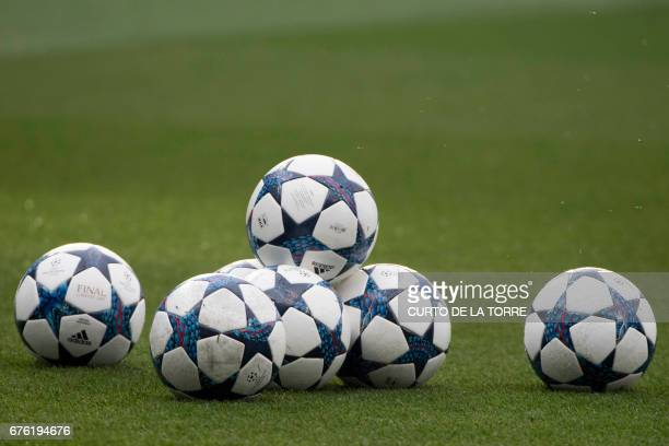 Official UEFA football balls on the pitch before the UEFA Champions League semifinal first leg football match Real Madrid CF vs Club Atletico de...
