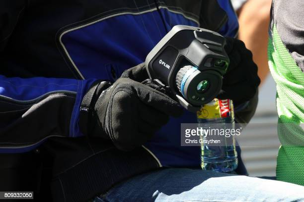 UCI official uses a FLIR thermal camera during stage five of the 2017 Le Tour de France a 1605km stage from Vittel to La plance des belles filles on...