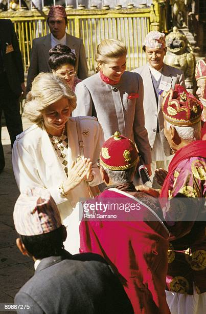 Official visit of the King and Queen of Spain to Nepal The queen Sofia and the infanta Cristina greets a group of monks