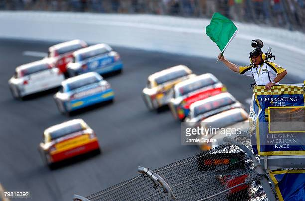 NASCAR official waves the green flag during the NASCAR Sprint Cup Series Daytona 500 at Daytona International Speedway on February 17 2008 in Daytona...