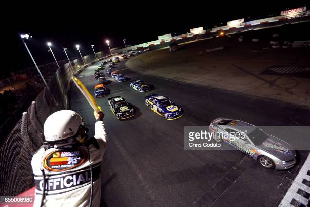 NASCAR official waves the yellow flag before the start of the NASCAR KN Pro Series West NAPA Auto Parts 150 at Tucson Speedway on March 18 2017 in...