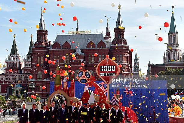 Officials and former and current football players start the 1000day countdown to the 2018 FIFA World Cup at Manezhnaya square in Moscow on September...