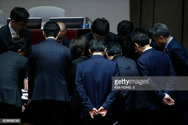 TOPSHOT Officials and lawmakers count votes after voting on the impeachment bill of South Korean President Park Geunhye at the National Assembly in...