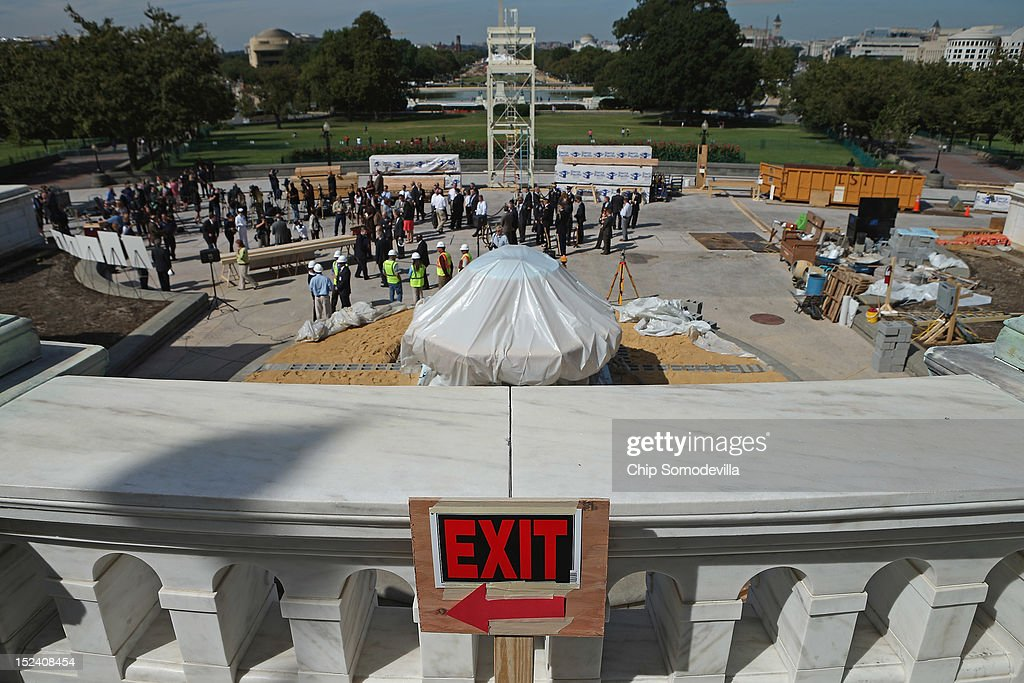 Officials and members of the news media gather on the West Front of the U.S. Capitol for the 'First Nail' ceremony, signifying the start of construction of the 2013 Inaugural Platform, September 20, 2012 in Washington, DC. The winner of the November 6 presidential election will be sworn in on the platform on January 21, 2013.