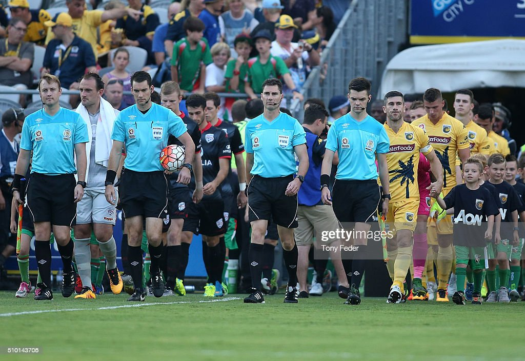 Officials and players walk out before the start of the game during the round 19 A-League match between the Central Coast Mariners and Adelaide United at Central Coast Stadium on February 14, 2016 in Gosford, Australia.