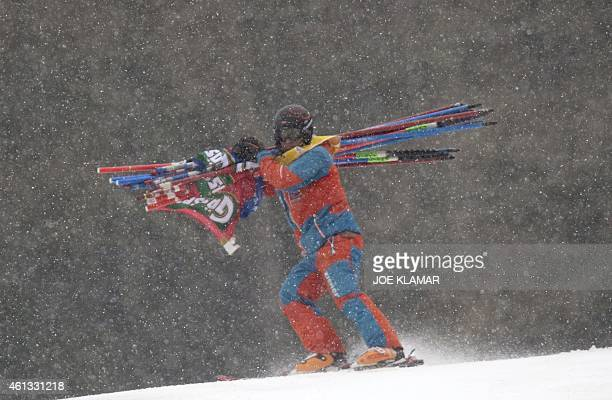 Officials are closing the women's Super G course during the FIS Ski World cup in Bad Kleinkirchheim Austria on January 11 2015 The race was cancelled...