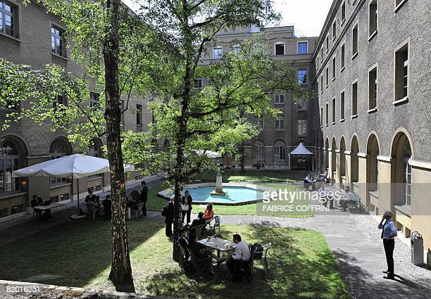 Officials are pictured in the garden of the World Trade Organisation headquarters on July 21 2008 in Geneva Ministers from 35 key nations began a...