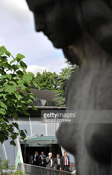 Officials are seen behind a statue as they leave the building holding the assembly room at the World Trade Organisation headquarters on July 21 2008...