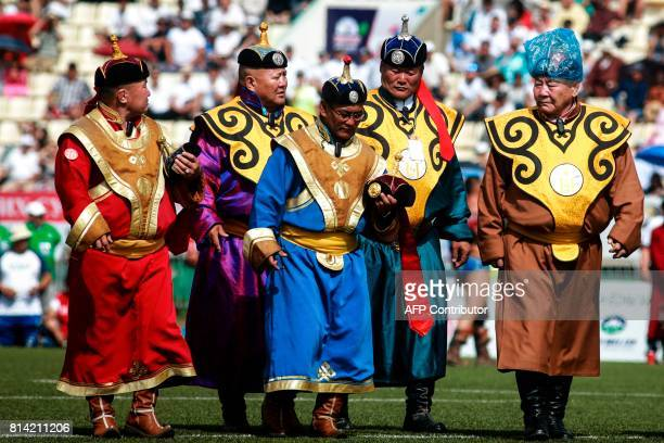 Officials arrive at the traditional Nadaam festival in Ulan Bator on July 12 2017 The festivities consist of a number of national ceremonies concerts...