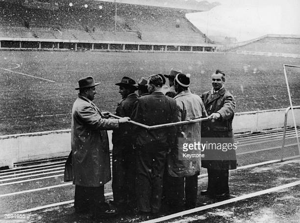 Officials at the Wankdorf Stadium in Berne Switzerland measuring crowd capacity before the World Cup