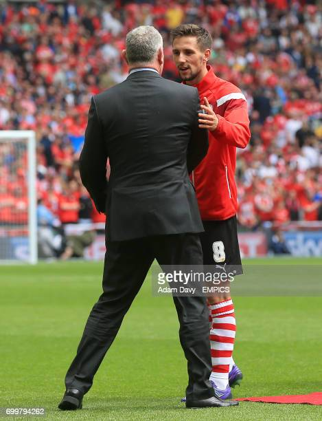 Officials awake hands with Barnsley's Conor Hourihane prior to the match