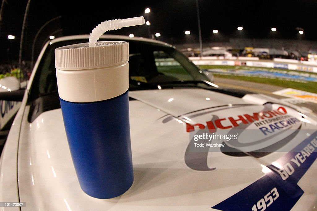 NASCAR officials confiscate a water bottle thrown on the track by Kevin Harvick (not pictured), driver of the #33 Armour Chevrolet, after Harvick won the NASCAR Nationwide Series Virginia 529 College Savings 250 at Richmond International Raceway on September 7, 2012 in Richmond, Virginia.