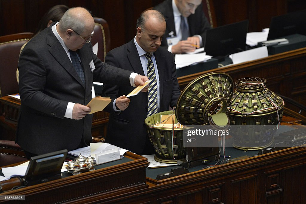 Officials count the votes during the first session of Italian lower-house on March 15, 2013 in Rome. General election in Italy took place on February 26 but as a majority in both chambers of parliament is required to form a government, Italy is left in a state of limbo with a hung parliament that is unprecedented in its post-war history. AFP PHOTO / ANDREAS SOLARO