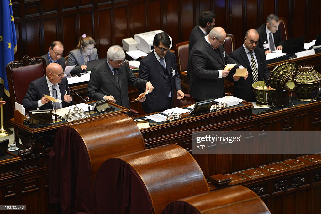Officials count the votes during the first session of Italian lower-house on March 15, 2013 in Rome. General election in Italy took place on February 26 but as a majority in both chambers of parliament is required to form a government, Italy is left in a state of limbo with a hung parliament that is unprecedented in its post-war history.