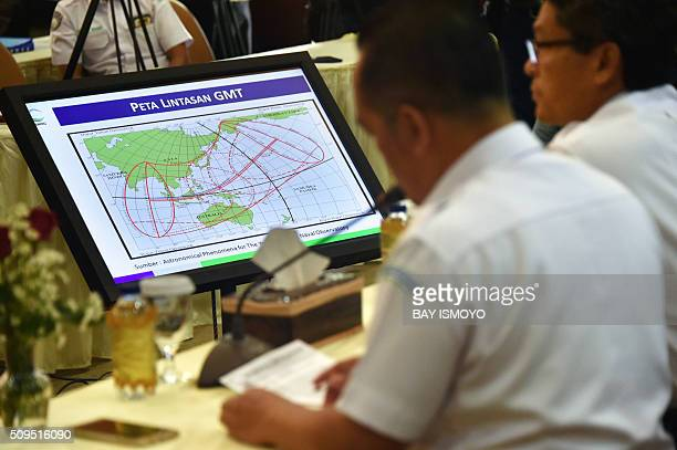 Officials display a map of the planned trajectory across the Indonesian archipelago of the upcoming March 9 total solar eclipse at a press briefing...