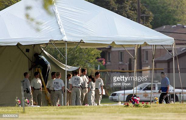 FBI officials erect a tent prior to the exhumation of Emmett Till at Burr Oak Cemetery June 1 2005 in Alsip Illinois The FBI is exhuming the body of...