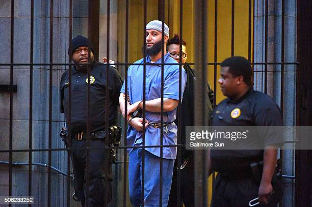Officials escort 'Serial' podcast subject Adnan Syed from the courthouse following the completion of the first day of hearings for a retrial in...