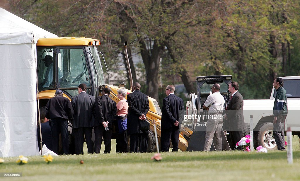 FBI officials family and friends watch as the remains of Emmett Till are exhumed at Burr Oak Cemetery June 1 2005 in Alsip Illinois The FBI is...