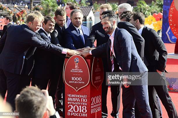 Officials former and current football players attend a countdown 1000day clock launch ceremony held at the Manezhnaya square in Moscow Russia on...