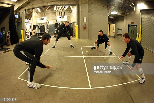 Officials from left Steve Miller Pierre Racicot Chris Rooney and Kelly Sutherland warmup before the start of a game between the Colorado Avalanche...