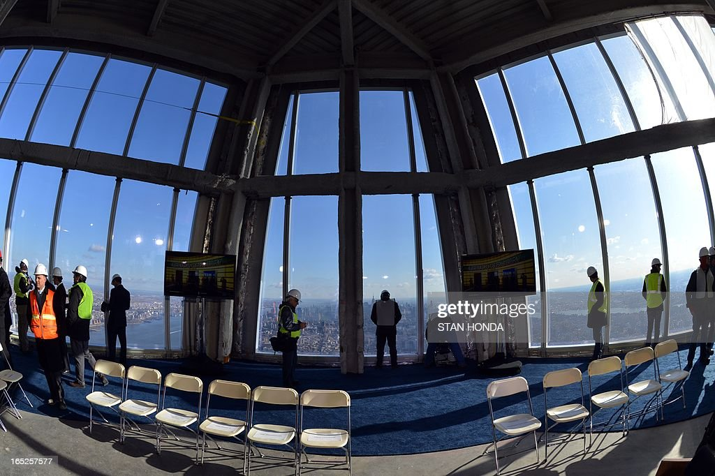 Officials from The Durst Organization, Legends Hospitality LLC and The Port Authority of New York & New Jersey give a preview to the news media of the One World Observatory site, the planned public observation deck under construction on the 100th floor of One World Trade Center April 2, 2013 in New York. AFP PHOTO/Stan HONDA