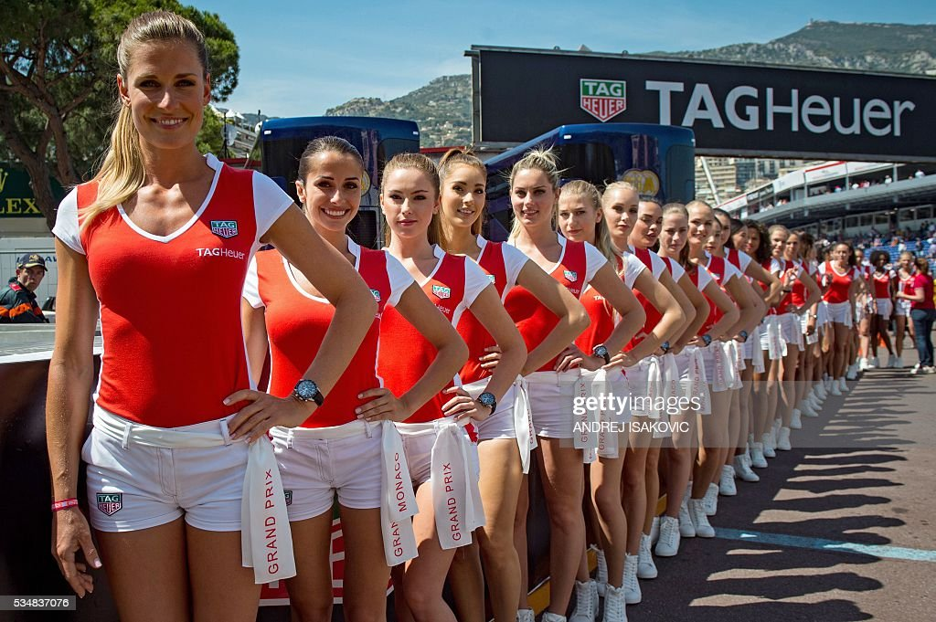 Officials hostesses stand in the track after the qualifying session at the at the Monaco street circuit, on May 28, 2016 in Monaco, one day ahead of the Monaco Formula 1 Grand Prix. / AFP / ANDREJ