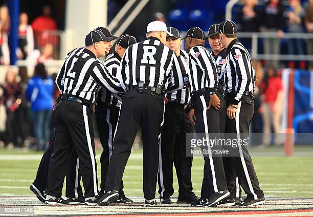 Officials huddle before the Military Bowl on December 27 at Navy Marine Corps Memorial Stadium in Annapolis MD Wake Forest defeated Temple 3426
