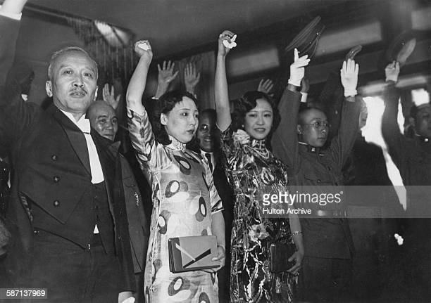 Officials in Hibiya Hall Tokyo Japan celebrate the coronation of Henry Puyi as Kangde Emperor of Manchukuo March 1934 From left to right The...