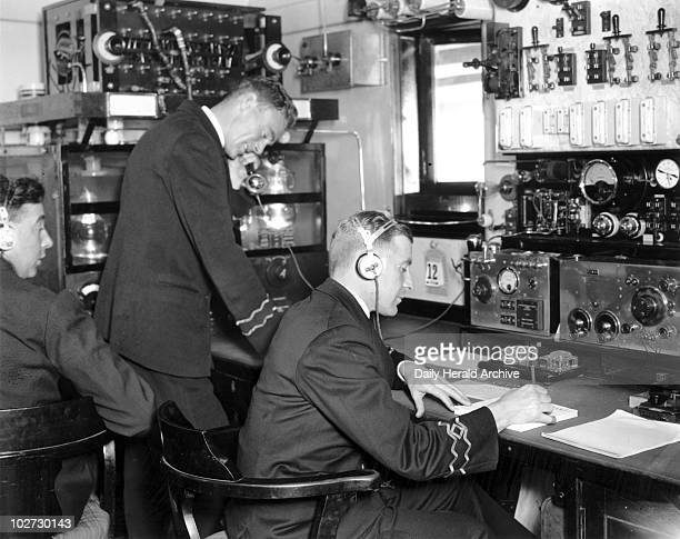 Officials in the wireless room on the 'Viceroy of India' 19 Febuary 1934 Officials in the wireless room on the PO liner 'Viceroy of India' Photograph...