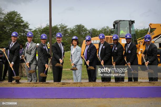 Officials including US Transportation Secretary Elaine Chao center and Maryland Gov Larry Hogan fourth from right led the Purple Line groundbreaking...