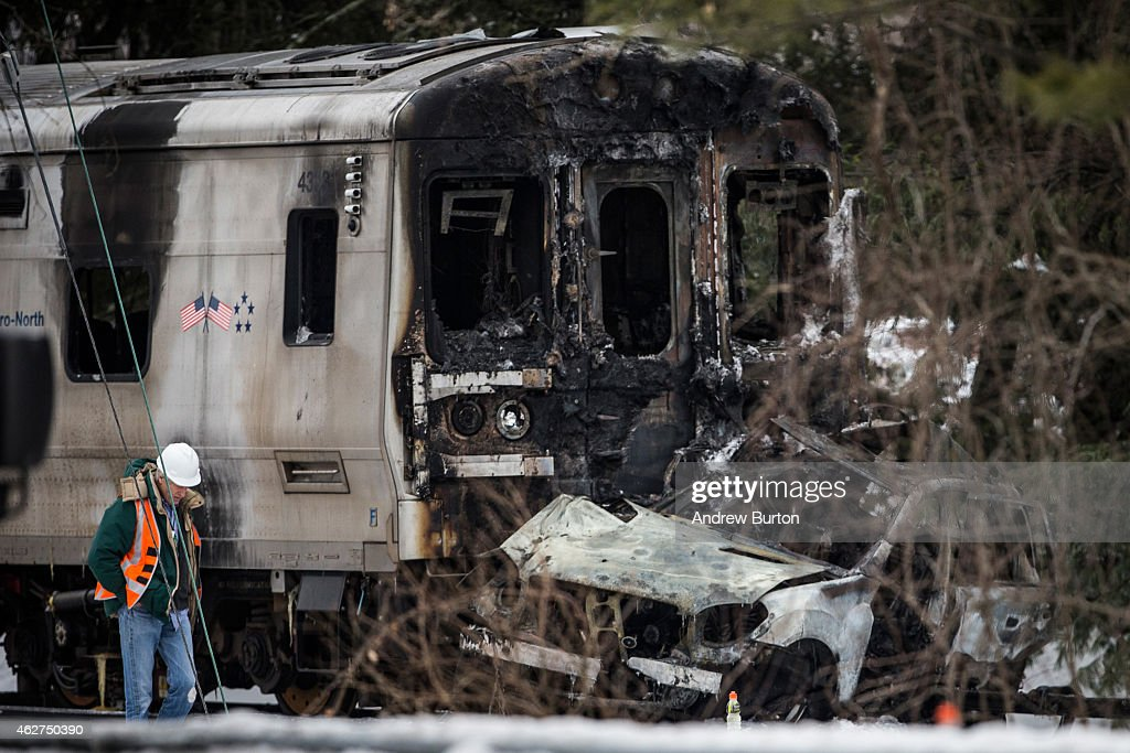Officials inspect a MetroNorth train crash with a sport utility vehicle that occured last night on February 4 2015 in Valhalla New York The crash...