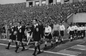 Officials lead out the teams before a friendly international between England and Hungary at the Nepstadion Budapest 23rd May 1954 The England team in...