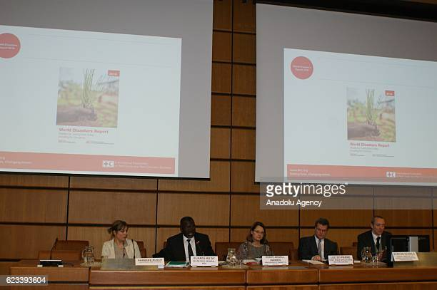Officials of the Nations Office for Outer Space Affairs and International Red Cross and Red Crescent Movement are seen during a media conference to...