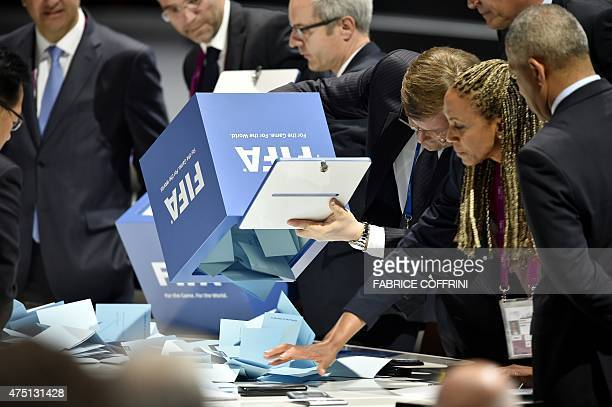 Officials open ballot boxes as vote counting got underway following the vote to decide on the FIFA presidency in Zurich on May 29 2015 Sepp Blatter...