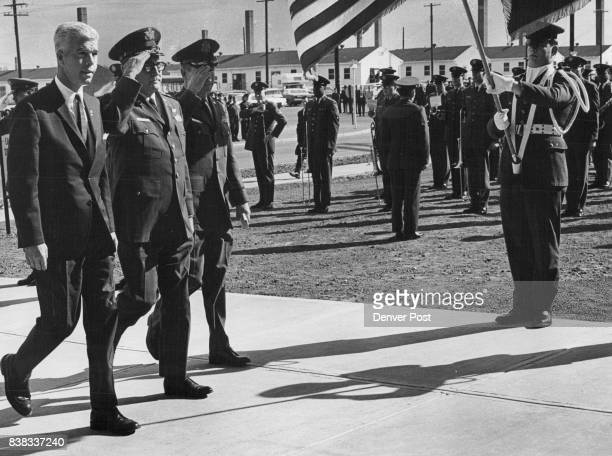 Officials Pass In Review During Ceremony At Lowry Air Force Base Supply Center Monday From left are Sen Peter Dominick RColo Maj Gen Dwight O...
