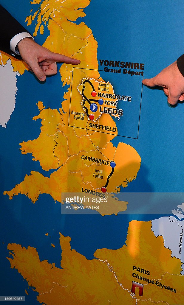 Officials point to a map during a press conference announcing the routes for the 2014 Tour De France at Leeds Town Hall in Leeds, northern England, on January 17, 2013. The 2014 Tour de France will start with a stage between Leeds and Harrogate in the northern English county of Yorkshire on July 5, organisers of cycling's most prestigious and gruelling race announced.