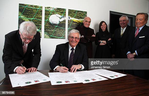 officials Reinhard Rauball and Theo Zwanziger sign the charter of the Robert Enke Foundation in presence of Martin Kind Teresa Enke widow of...